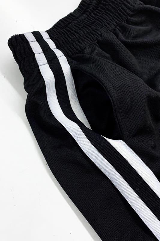 black enfant-sauvage-short-authetique-detail-bande-laterale-sport